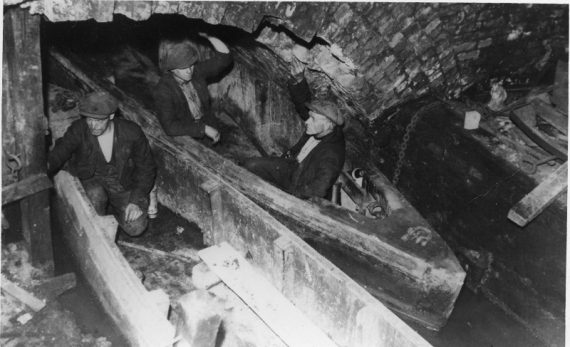 Photo of miners in boats in the underground canals of the Worsley colliery