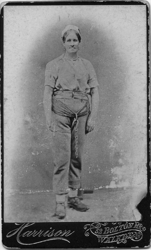 Late 19th century portrait photo of a woman worker in clogs and working clothes