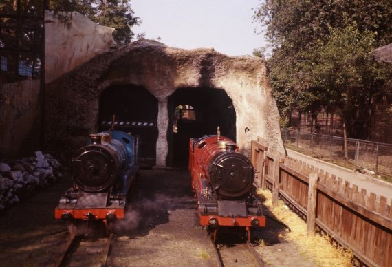 Photo of 'Railway Queen' and 'Joan' outside the tunnel-cum-shed on the miniature railway, 1977. Copyright Jon Cocks.